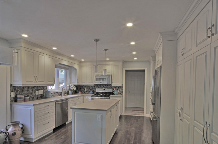 Off-white kitchen cabinets - new kitchen delivers more space ...